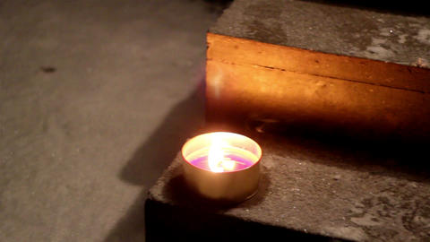 A candlelight placed on a stair Live Action