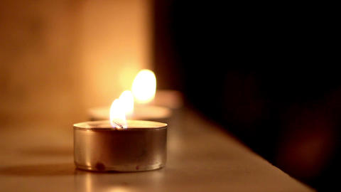 Three candle lights aligned to each other Footage