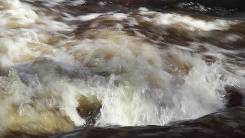Rapids of water creating bubbles Footage