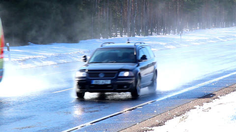 Two cars running fast on the road with snow Footage