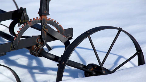 Wheel of an old agri tool stuck on the snow Footage