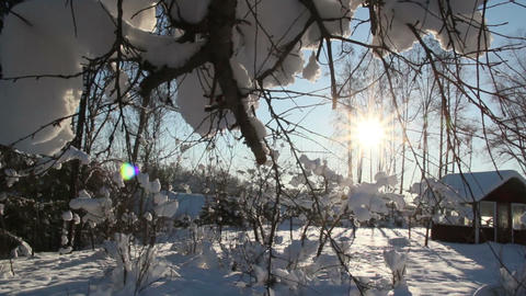 The sun shines so bright on the snow covered area Footage