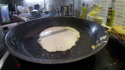 A man is cooking a pancake Footage