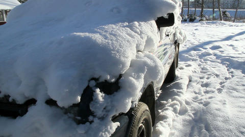 A parking car is covered with snow Footage
