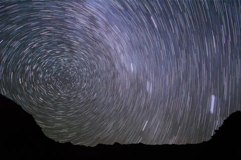 Stars line over the mountains. Time Lapse. 4K+ Footage