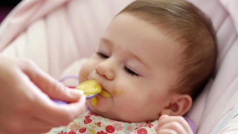 Baby Girl Eating Lunch stock footage