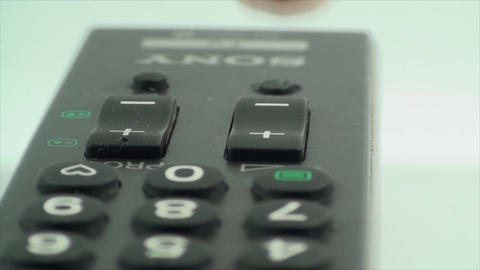 Finger Touching The Volume Button On A TV Remote,  Footage