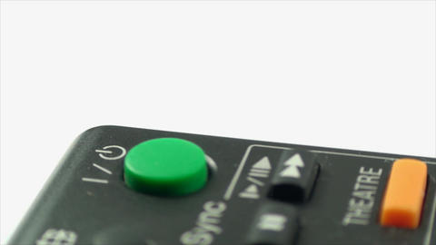 Finger Touching The Stand By Button On A TV Remote Footage