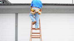 Contractor Climbing Ladder stock footage