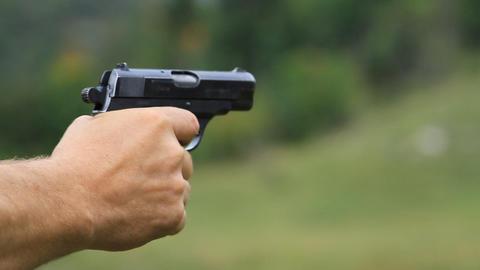 Man firing from a gun to target Footage