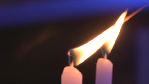 Burning Candles In Sconces On Black Blue Backgroun stock footage