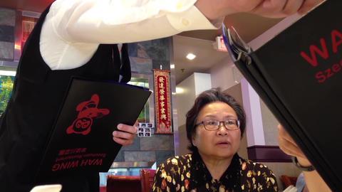 People ordering food inside Chinese restaurant Footage