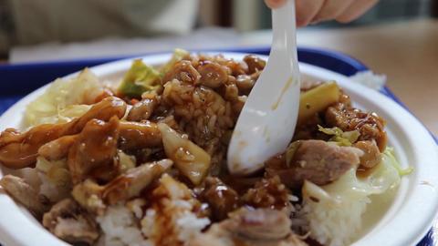 People eating Japaness food called teriyaki chicke Footage