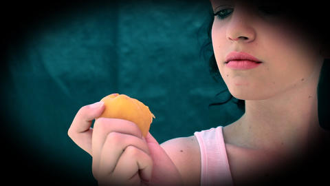 Girl is eating apricot Live Action