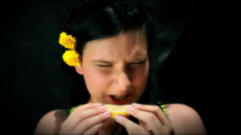 Girl is eating lemon Live Action