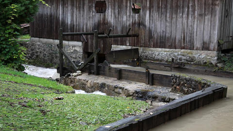 Water mill and a wooden object in the midlle Footage
