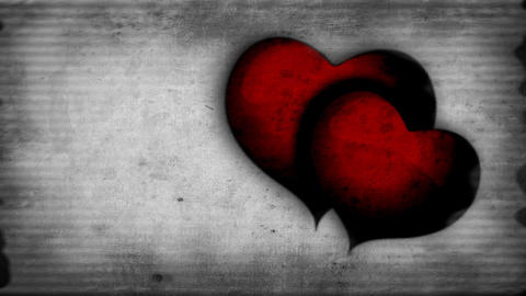 Two red beating hearts on a old-movie effect backg Footage