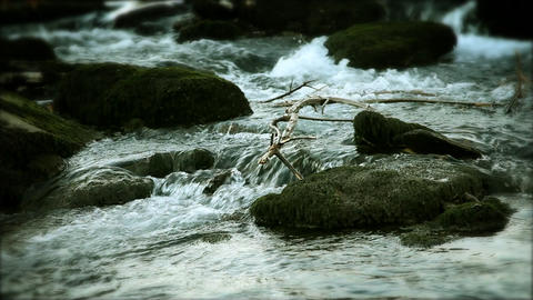 river running by stones Footage