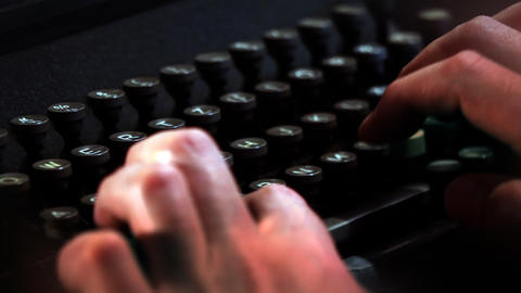 hands writing on typewriter Live Action