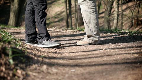 men's leg walking on forest path Footage