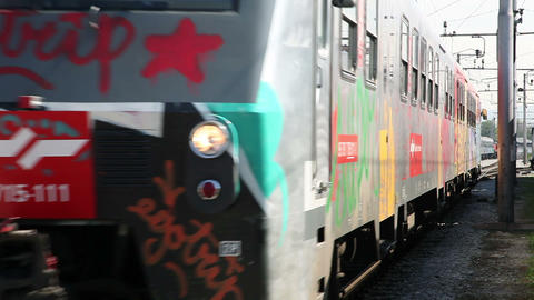 Moving train with graffiti on wagons and locomotiv Footage
