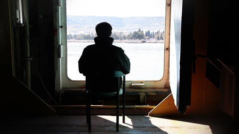 Man looking at sea and waving Footage