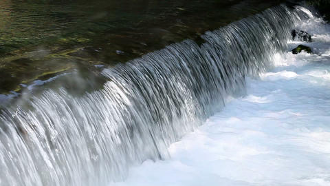 Still shot of a waterfall Live Action