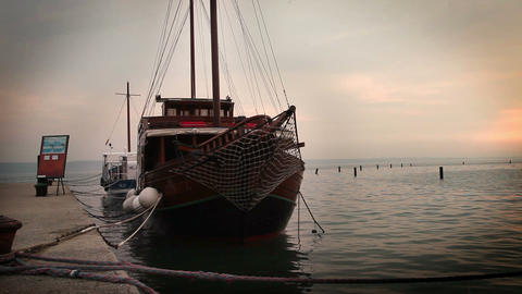 Old Touristic Boat Dockedin The Port stock footage