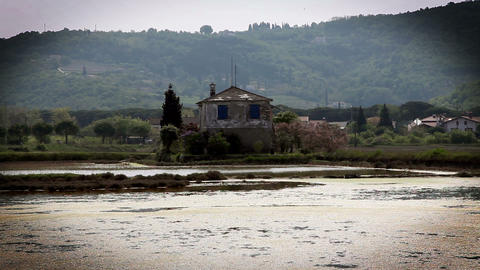 old house in the midlle of the Salt pans Secovlje Live Action
