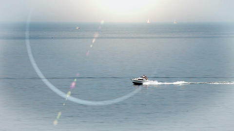 speedboat on the sea with a lens flare in the came Footage