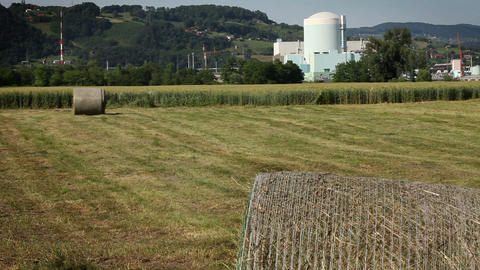 grain field with nuclear power station in the back Footage