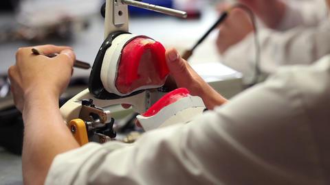 Professional dentist Develops dental prosthesis Live Action