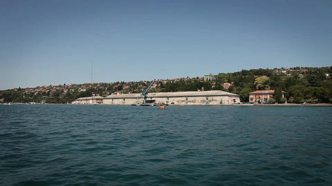 Shot of shore near Piran made from the moving boat Live Action