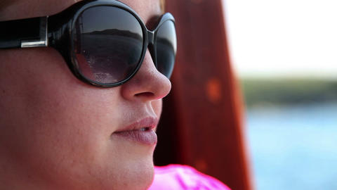 Close up shot of a young woman on a boat Live Action