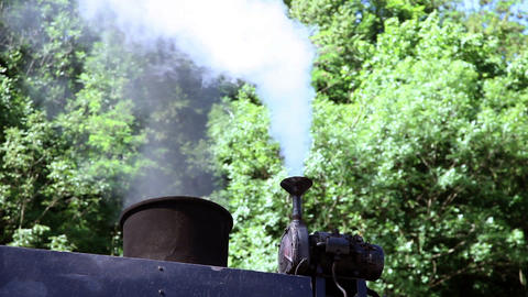 the steam going out of the chimney of the steam lo Live Action