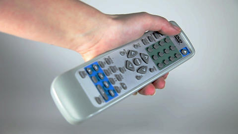 woman hand holding remote Live Action