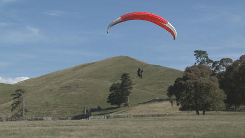 para glider landing in a field Footage