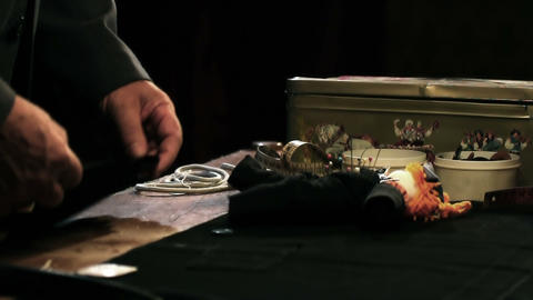 Close up shot of the tailors hands, working on a d Live Action