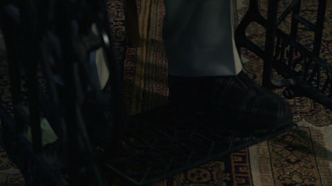 Close up shot of the tailor`s legs , running a sew Live Action
