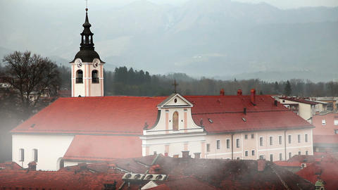 Still shot of church with morning mist in Kamnik,  Live Action