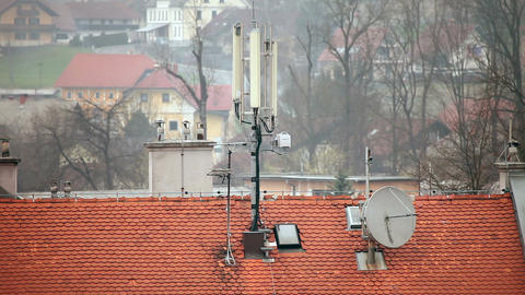Still shot of broadcasting objects on roof Live Action