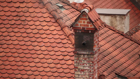 Still shot od smoking chimney on roof Live Action