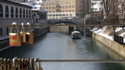 Wide shot of a focus on a boat on Ljubljanica rive Footage