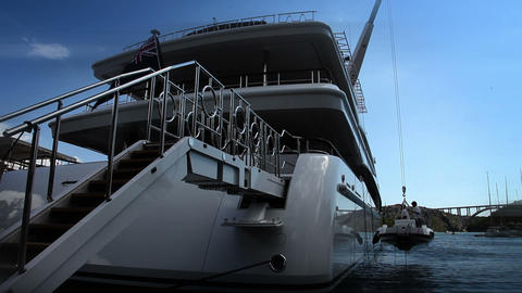 Close up shot of a luxury yacht docked in the port Footage