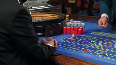 Playing roulette in casino Footage