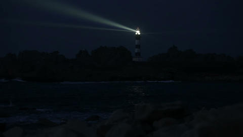 Very powerful lighthouse illuminated in night Footage