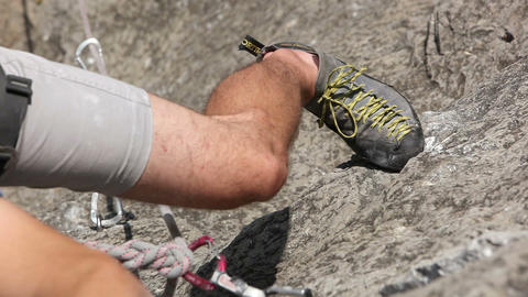 Close Up Of A Leg Of A Man Rock Climbing In Nature stock footage