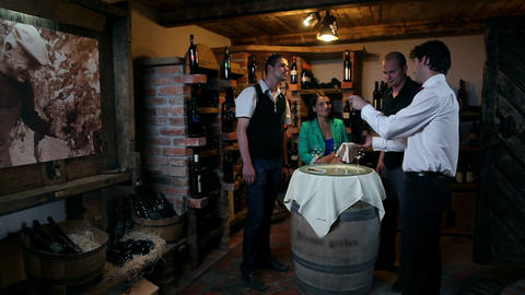 Business people wine tasting in a wine cellar Live Action