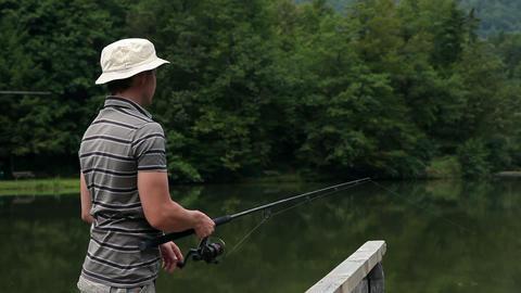 Slide shot of a man fishing Footage