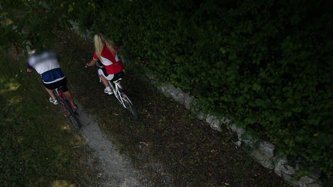A couple cycling shot above their heads Footage